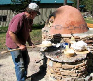 Dee with his pizza and bread oven