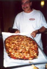 Albert with a Sally's Apizza