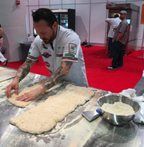 Tony Gemignani works the dough at Pizza Expo